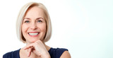 Attractive middle aged woman with beautiful smile on white background - 214560033