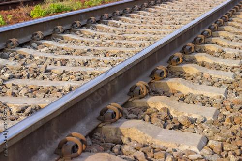 Foto Spatwand Spoorlijn Fragment of the modern railroad track close-up