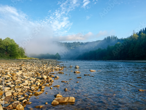 Foto Spatwand Bergrivier Mountain river with stone placers ashore and in water
