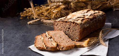 delicious and healthy home-made wholegrain bread with honey - 214570239