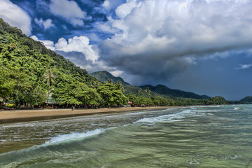 View of the beach and clouds over the island during the rainy season