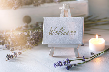 Spa or wellness still life: little image with lot of lavender in front of vintage wooden furniture and candlelight © Sonja Birkelbach