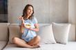 Leinwandbild Motiv Happy young woman eating healthy breakfast