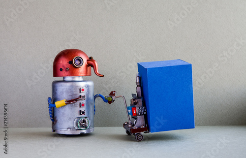 Robot courier moving big blue container with powered pallet jack. Forklift cart mechanism on gray background. Robotic logistic delivery service concept. Copy space