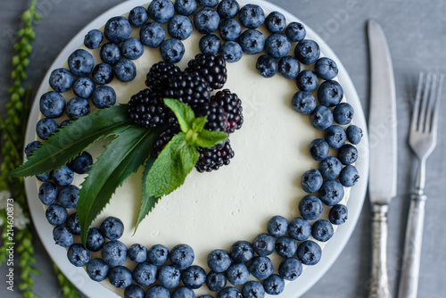 Foto Murales Beautiful tasty cake with white cream and berries of blueberry