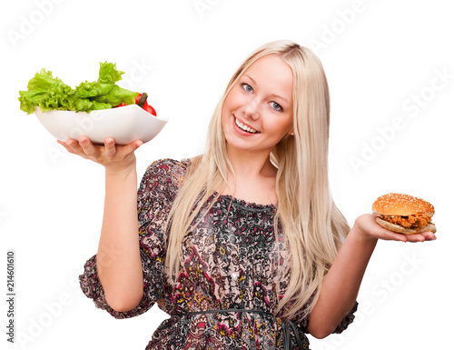 Leinwandbild Motiv beautiful young blond woman with a burger and salad