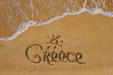Greece word on sandy summer beach - 214622645