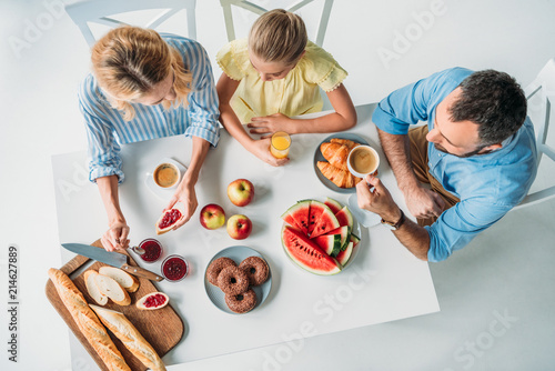 top view of young family having breakfast together - 214627889
