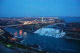 Aerial View of Rainbow Bridge and American Falls of Niagara Falls at night in winter, New York State, USA.
