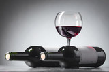 Bottles and glass of red wine . - 214646228