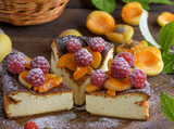 pieces of cottage cheese pie with strawberries and apricots