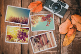 Retro camera and photo of memorie and nostalgia in fall.  Autumn memories concept. vintage color effect. - 214704026