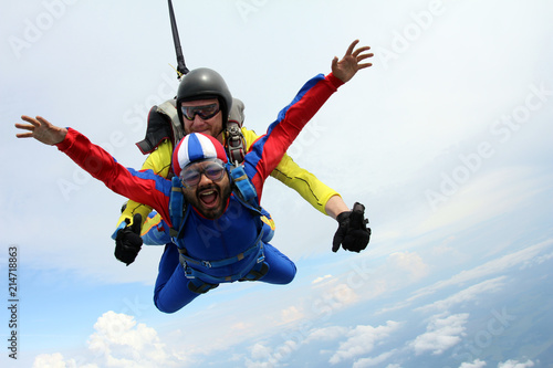 Tandem skydiving. Indian man is in the sky.