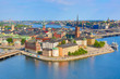 Leinwanddruck Bild - Gamla Stan, the old part of Stockholm in a sunny summer day, Sweden. Aerial view from Stockholm City hall Stadshuset.
