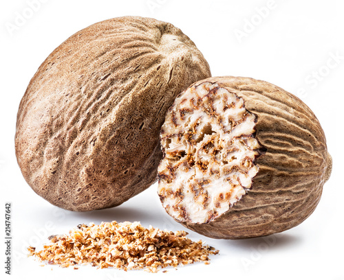 Foto Murales Dried seeds of fragrant nutmeg and grated nutmeg  isolated on white background.
