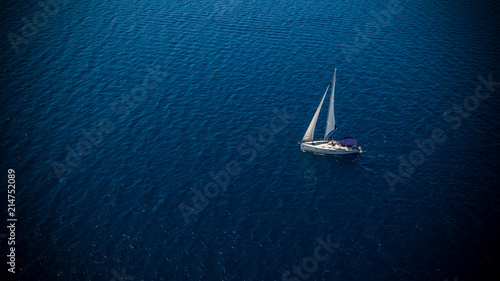 Leinwandbild Motiv Sailing boat on open water, aerial view