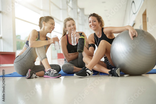 Fitness girls relaxing after workout - 214754819