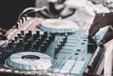 DJ plays and mix music on digital midi mixer controller - 214773035