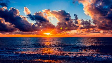 Colorful sunset over ocean © EwaStudio
