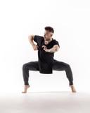 Young beautiful dancer is posing in studio - 214794497