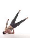 Young beautiful dancer is posing in studio - 214794653