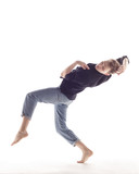 Young beautiful dancer is posing in studio - 214794816