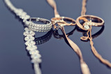 gold rings with diamonds, pearls and precious stones