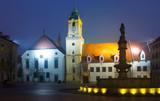 Main Square  in old historic city  Bratislava illuminated at dusk