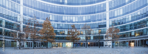 Naklejka Modern office buildings and trees in an autumn robe