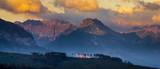 Mountain peaks lit by the rising sun. Tatra Mountains , Poland - 214812631