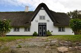 Front of a white frisian house by jziprian
