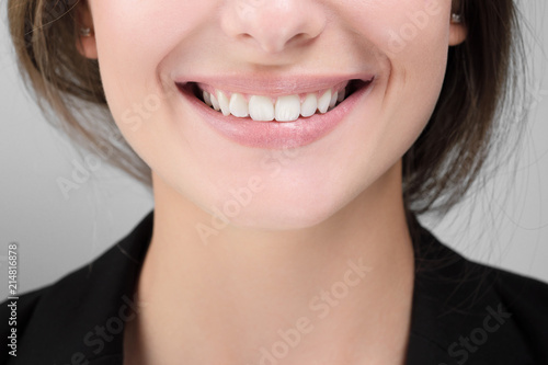Closeup of woman smile with white healthy teeth