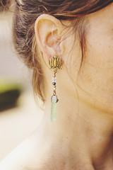 Woman wearing decorative long earrings © marbenzu