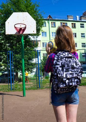 Foto Spatwand Basketbal School Girl Shooting Basketball and Playing Basketball