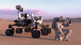 Astronaut with mars rover, cosmonaut kneeling next to robotic space autonomous vehicle on a deserted planet, 3D rendering
