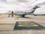 Private luxury jet at the airport terminal - 214822496