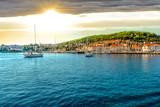 Boats in the harbor of the Croatian coastal city of Hvar, one of the many Islands near Dubrovnik and Korcula on the Dalmatian Coast of Croatia - 214825427