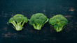 Fresh green broccoli. Raw Vegetables. On a wooden background. Top view. Copy space.