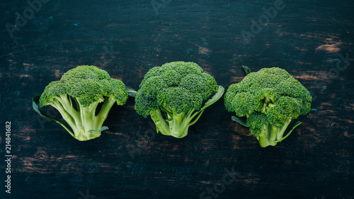 Foto Murales Fresh green broccoli. Raw Vegetables. On a wooden background. Top view. Copy space.