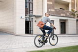 Eco friendly. Happy positive man riding a bicycle while going to work - 214846471