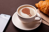 Cup of coffee with the idea of a light bulb on the foam. Coffee gives new ideas and creativity. Morning coffee - 214887497