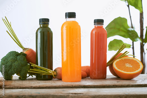 Canvas Sap Various bottle of juice on a wooden table in the garden