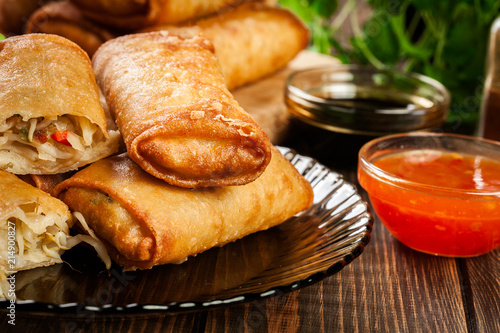Foto Murales Spring rolls with chicken and vegetables served with sweet chili sauce or soy sauce