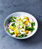 Yellow tomato salad with lettuce, red onion and feta cheese. Homemade food - 214903217