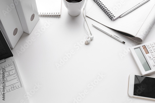 Foto Murales Business Items dropped in creative Disorder on white Table
