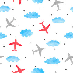 Seamless baby boy pattern with watercolor planes and clouds.