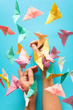 Mental health concept. Colorful paper butterflies flying and sitting on womans hands. Harmony emotion. Origami. Paper cut style.