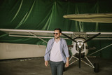 Young man in the airplane hangar