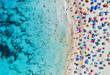 Aerial view of sandy beach with colorful umbrellas, swimming people in sea bay with transparent blue water in sunny day in summer. Travel in Mallorca, Balearic islands, Spain. Top view. Landscape