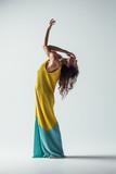 Beuatiful female dancer. Studio background. - 214982831